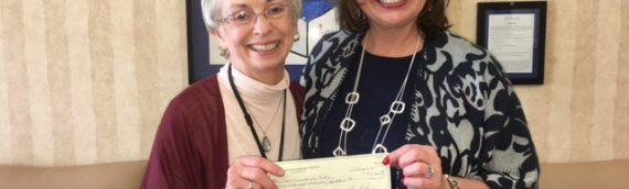St. Vincent Receives Check from First Rule